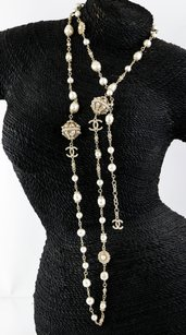 Chanel Chanel Pearl like strands faberge & CC Charms Necklace.