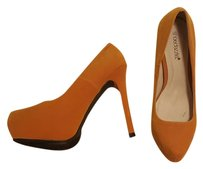 ShoeDazzle Yellow Pumps