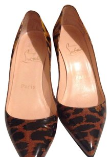 Christian Louboutin Black & tan Pumps