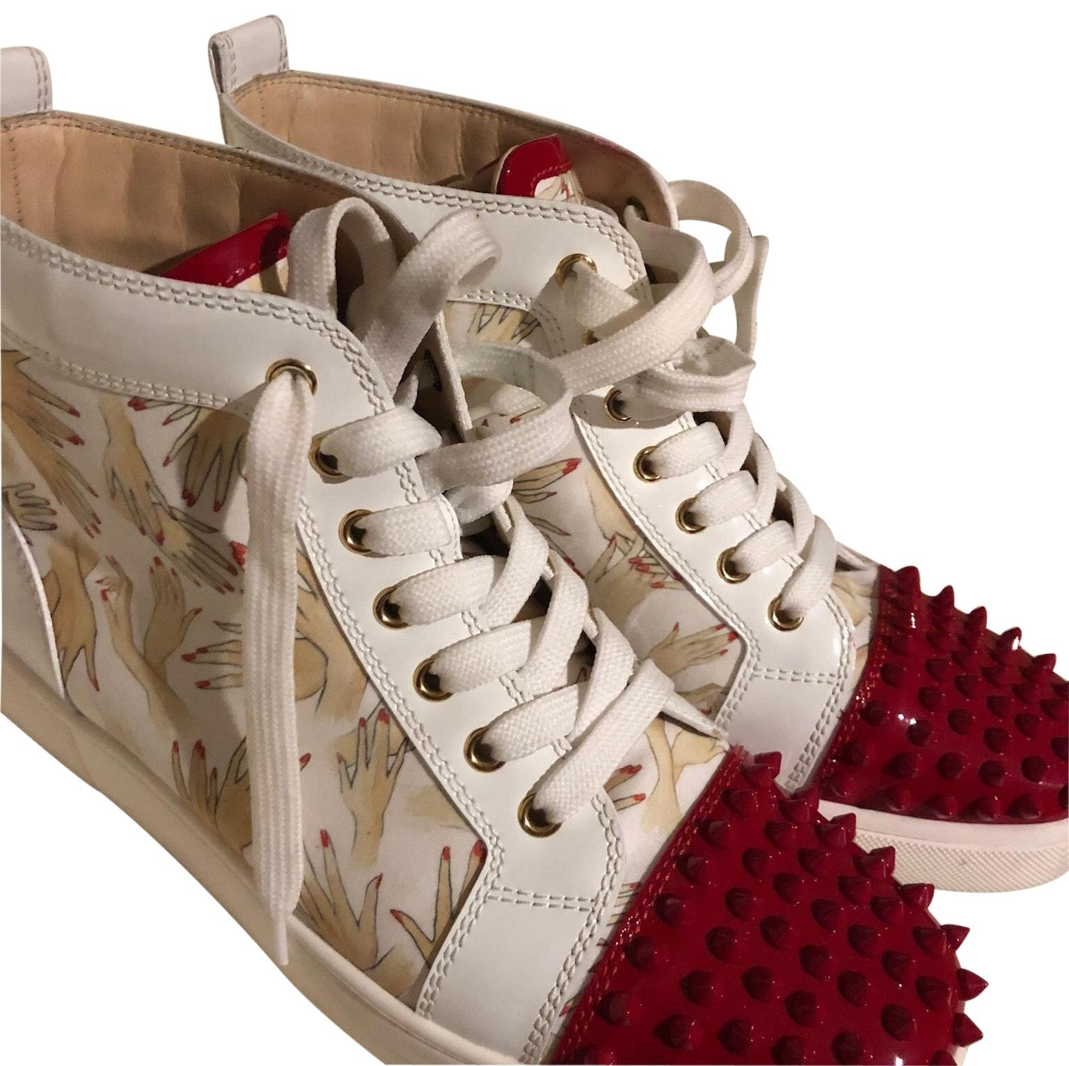 louboutin gold studded sneakers