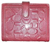 Coach COACH ID/Card holder. Pink Patent Embossed Leather. Snap closure