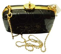 Coach Embrossed C Stitch Rare Black Clutch