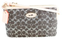 Coach Zip Small Wristlet in Saddle Apricot