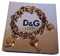 Dolce&Gabbana D&G Dolce & Gabbana Multi-Chain Charm Bracelet. Color is antique brass gold color.