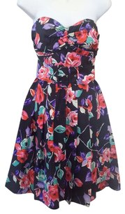 Express short dress Black background with multicolor floral print Strapless on Tradesy