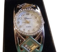 Gruen ll Gruen bangle gold tone watch with floating crystals