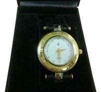 GG gold tone watch trimed in silver with leather strap