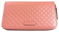 Gucci GG leather pink zip wallet