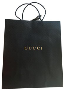 Gucci Gucci gift bag with gold bow on top