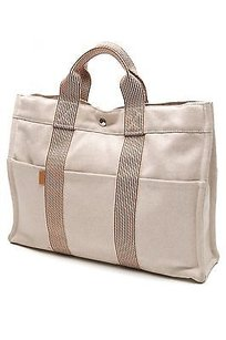 Hermès Hermes Beige Canvas Fourre Tote in Beige, brown