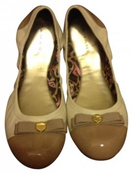 http://item2.tradesy.com/images/item/1/shoes/elie-tahari/8/tahari-cream-and-tan-flats-400101-0.jpg