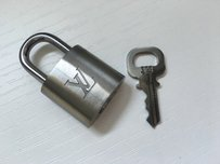 Louis Vuitton #323 BRUSHED TITANIUM. One of a kind . Authentic Lock And Key Set