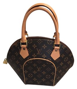 Louis Vuitton Leather Monogram brown Clutch