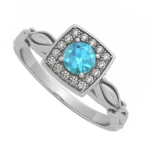 LoveBrightJewelry Blue Topaz And Cubic Zirconia Ring In Sterling Silver