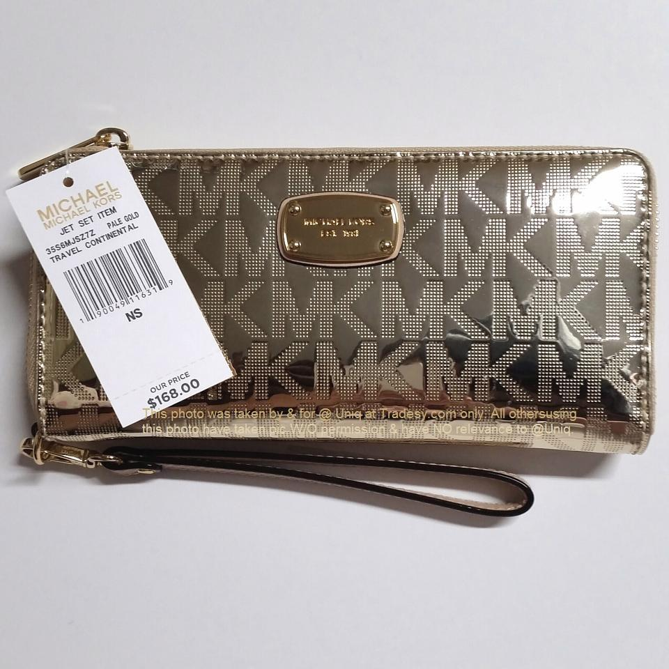 9dcc9c70c9f3 coupon code michael kors saffiano jet set black leather wallet 59703 5393a;  canada michael kors gold sale metallic mirror zip travel continental 36daf  d6ed8