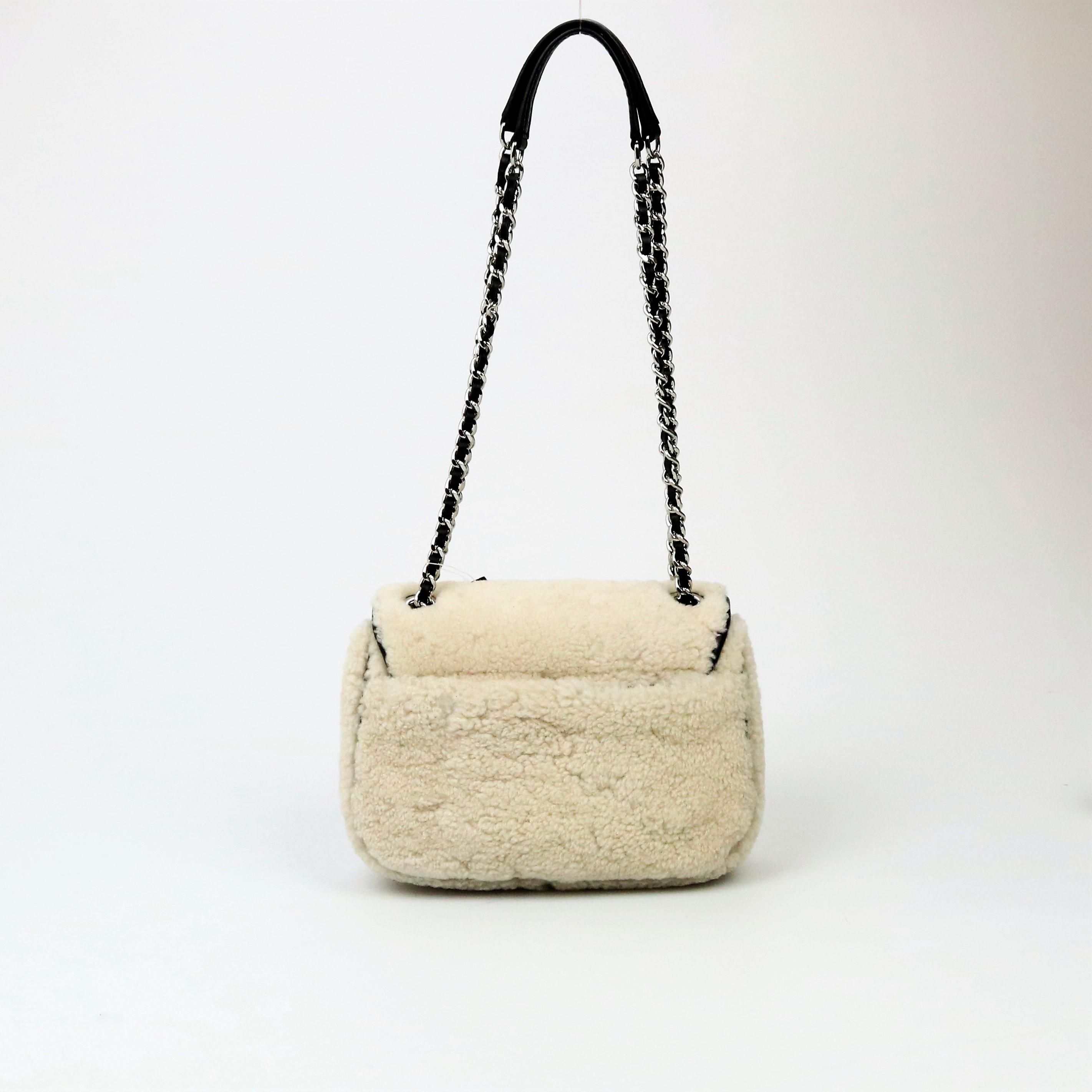 41d8a1d3bd2e ... closeout michael kors mk shearling sloan wool shoulder bag. 12345678  25c81 7fc9a