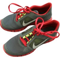 Nike Grey with red and a touch of lime green Athletic