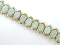 Other 18kt Gem Opal Yellow Gold Tennis Bracelet 27-stones 13.00ct
