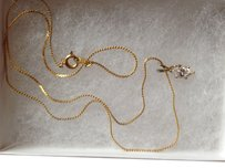 Gold-tone 18 in. chain with oval Zirconia Pendant