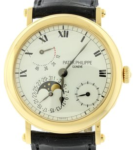 Patek Philippe Authentic Patek Philippe Complications Solid 18k Yellow Gold Power Reserve Moonphase 5054 J Watch Complete with Original Box & Papers