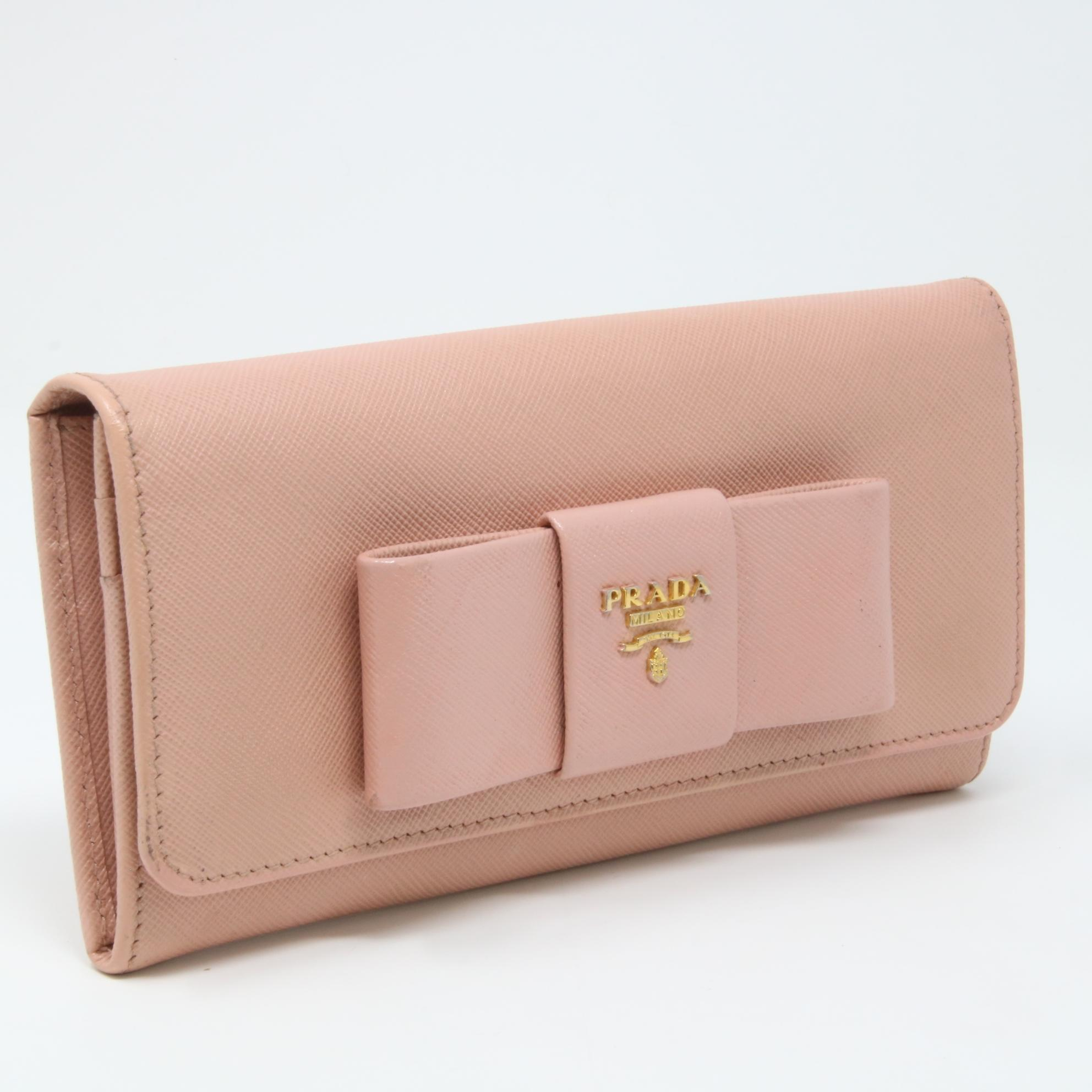 ... store prada classic saffiano ribbon logo leather bow long wallet.  1234567891011 113c9 ead6c f9e748e42e927
