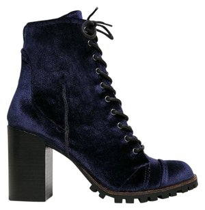 REPORT Blue Boots