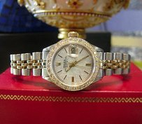 Rolex Ladies Vintage Rolex Oyster Perpetual Date Diamond Bezel Yellow Gold Steel Watch