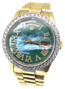 Rolex Rolex Day-Date Green Mother of Pearl Roman Diamond 18k Yellow Gold Watch