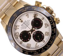 Rolex Rolex Daytona 18k Yellow Gold-White/Black Arab Dia-116528