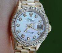 Rolex Rolex Ladies President 18k Yellow Gold 69178 Diamond Mother Of Pearl Dial Bezel