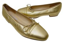 Saks Fifth Avenue Italy Gold Flats
