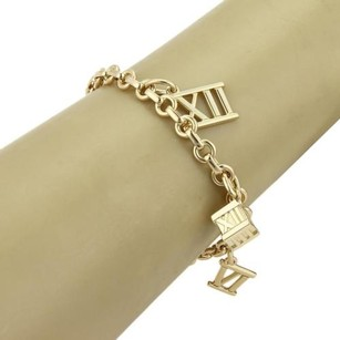 Tiffany & Co. Tiffany Co. Atlas 18k Yellow Gold Roman Numeral Charms Chain Bracelet