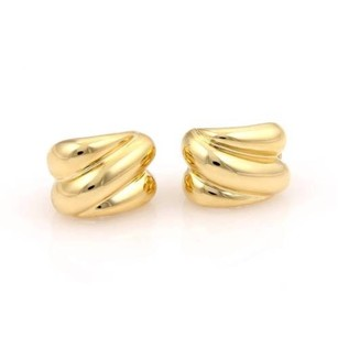 Tiffany & Co. Tiffany Co. 18k Yellow Gold Ribbed Swirl Design Huggie Earrings
