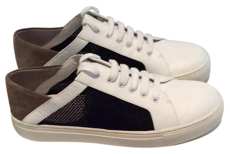 Vince sneaker in white leather, black mesh and taupe suede aat heels. Brand new, unworn. Size 6. Very pretty and goes well with lots of colors.